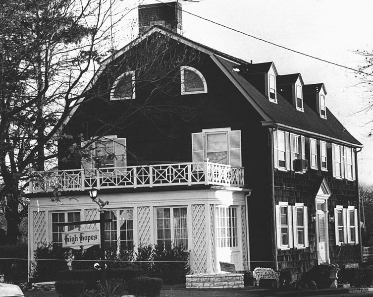 Black and white photo of haunted Amityville House