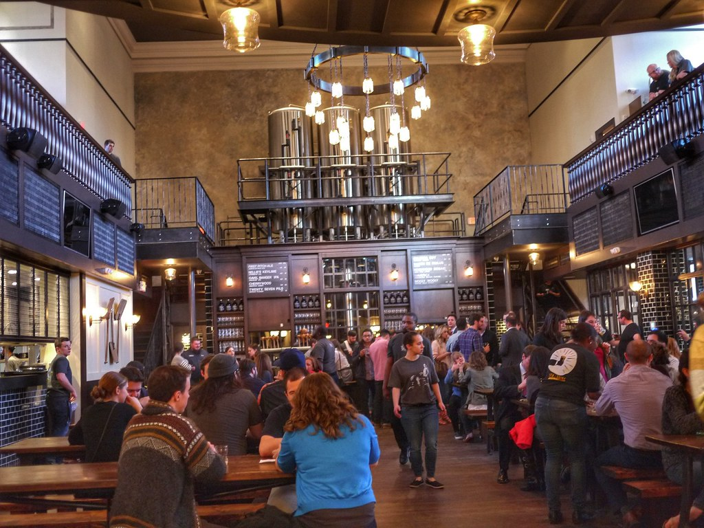photo shows people inside taft's ale house sitting at tables and moving about the establishment.