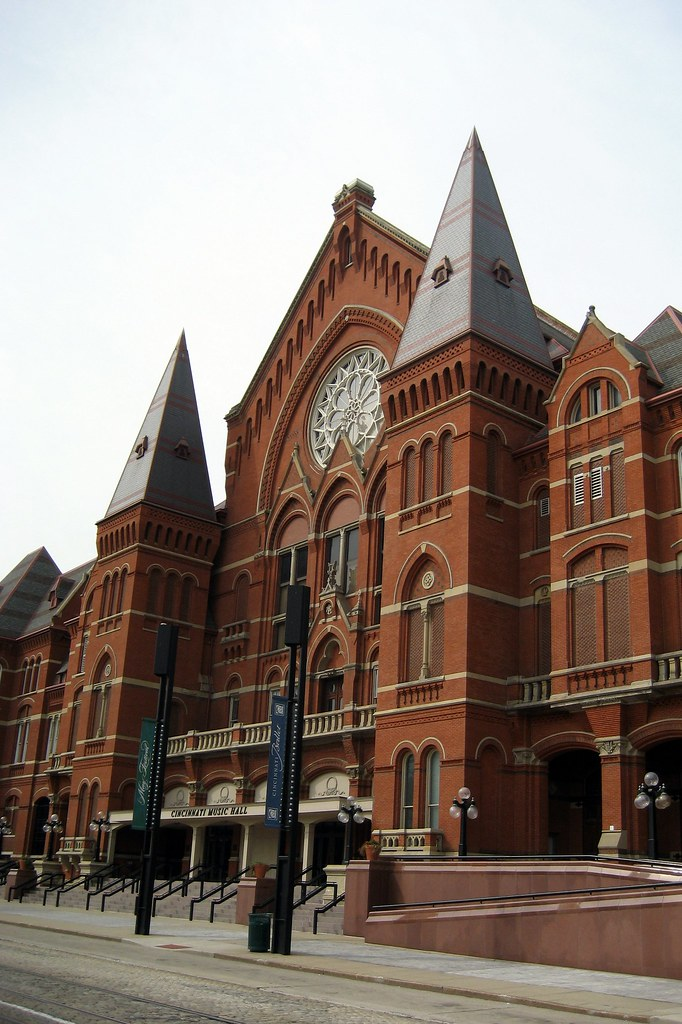 photo shows the facade of the cincinnati music hall, a large gothic style structure