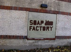 photo shows the side of the soap factory, with an old sign that says 'soap factory'